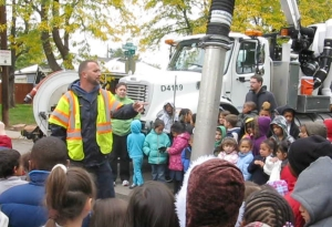 Denver's vacuum truck crew does a demonstration to teach kids about storm sewer pollution