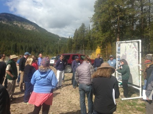 Participants on the Colorado Foundation for Water Education's transbasin diversion tour hear from Lynn Brooks with the Eagle River Water and Sanitation District beside the outlet of the Homestake Tunnel near Turquoise Reservoir.
