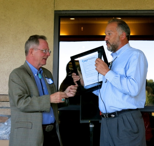 Gregg Ten Eyck, CFWE's Board President, presents Justice Hobbs with a proclamation from the Colorado River District.